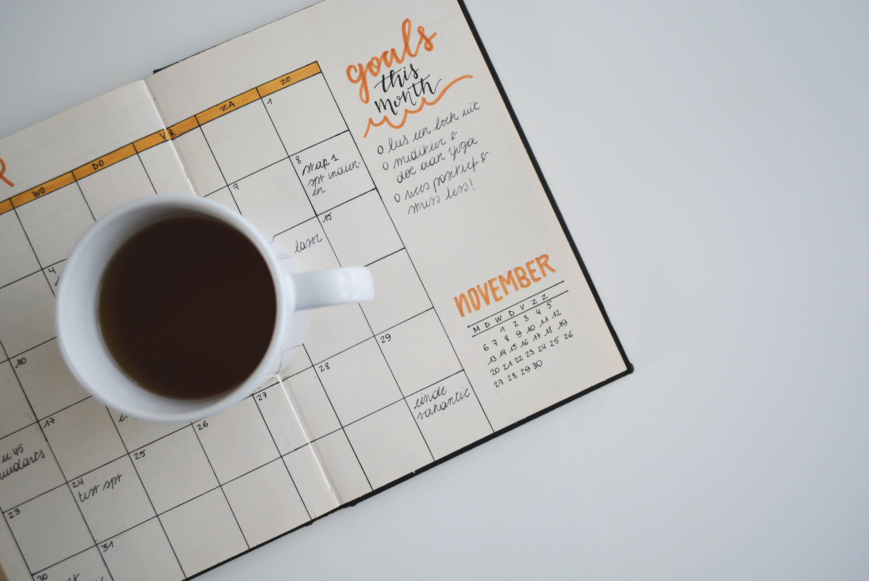 A picture of a cup of coffee and a calendar