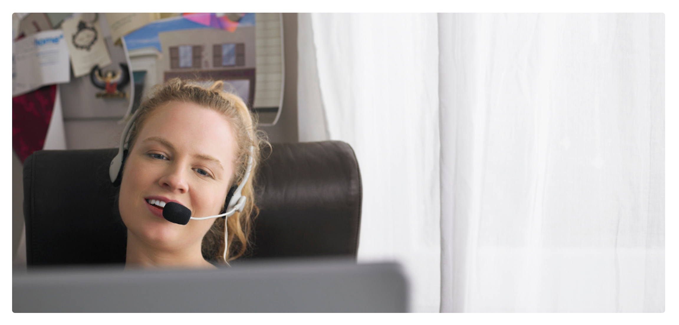 A picture of a woman talking to someone via Skype. She's teaching one of our online language courses.