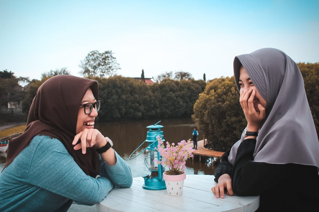 Women having a chat near the river